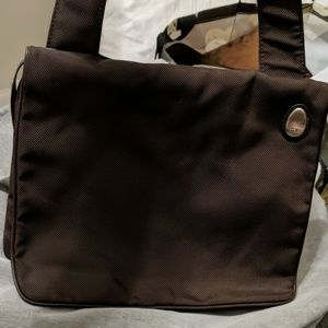 Tumi brown fabric and leather trim bag
